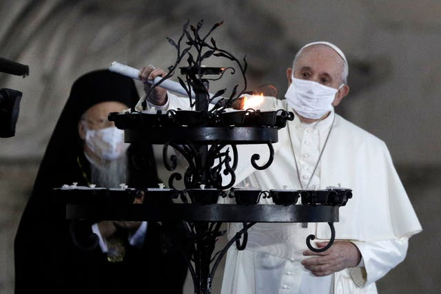 <p>The Pope lights a candle for peace with other religious leaders</p>