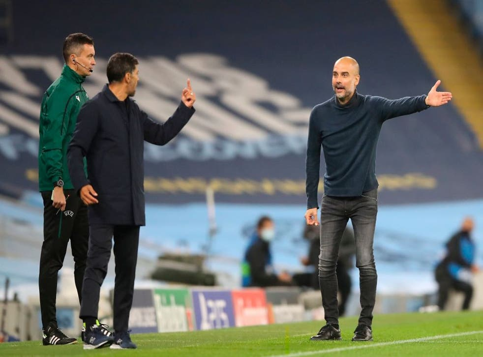 Pep Guardiola gestures as he exchanges words with Sergio Conceicao