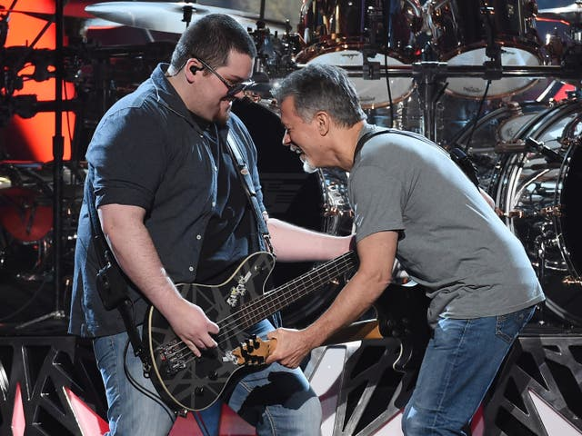 Bassist Wolfgang Van Halen (L) and guitarist Eddie Van Halen of Van Halen perform during the 2015 Billboard Music Awards