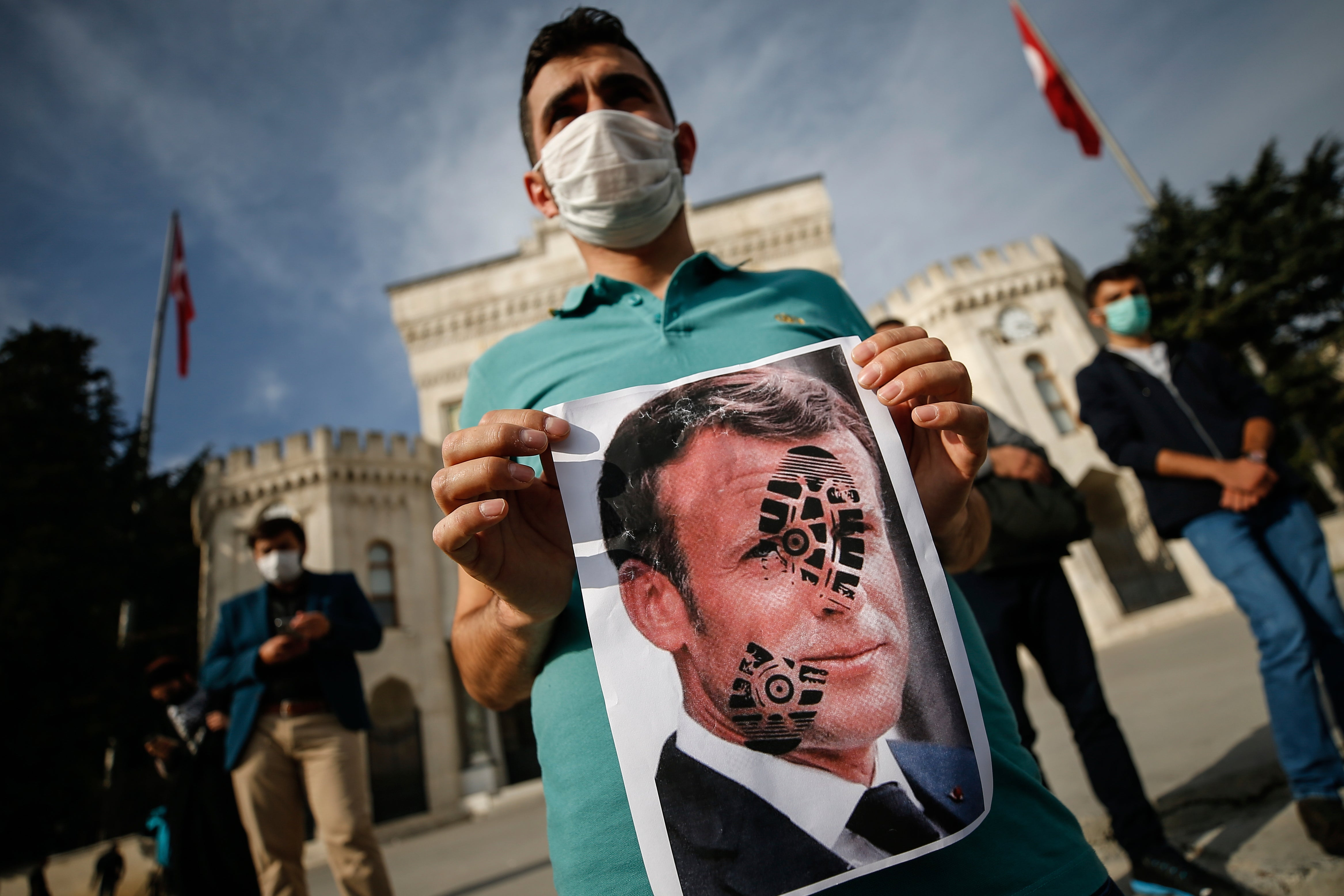 Muslims call for French goods boycott to protest caricatures Muhammad French Emmanuel Macron Teacher Muslims