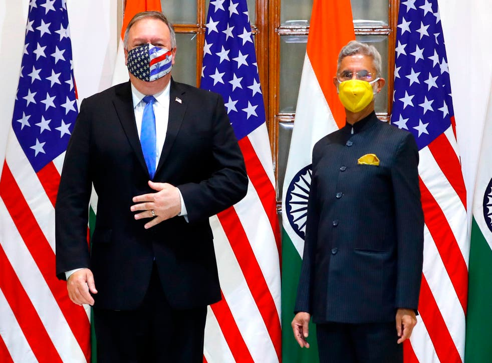 US Secretary of State Mike Pompeo (L) and India's Foreign Minister Subrahmanyam Jaishankar stand during a photo opportunity before their meeting at Hyderabad House in Delhi on Monday