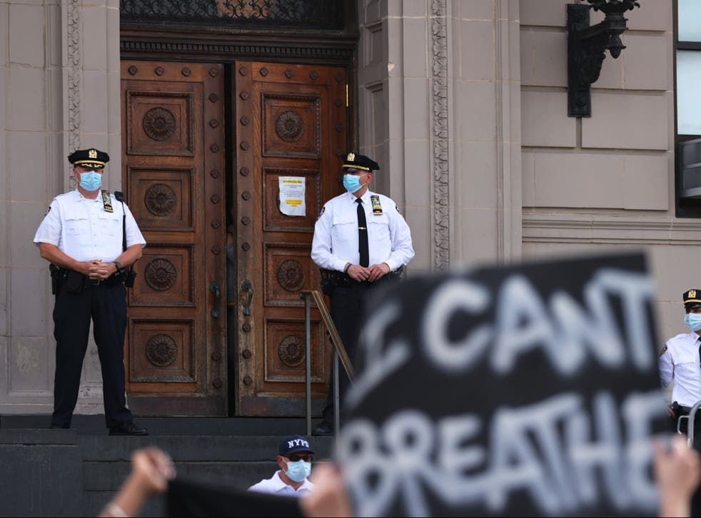 <p>Black Lives Matter protesters hold up a sign reading 'I can't breathe,' which individuals like George Floyd and Eric Garner said as they died in police custody.</p>