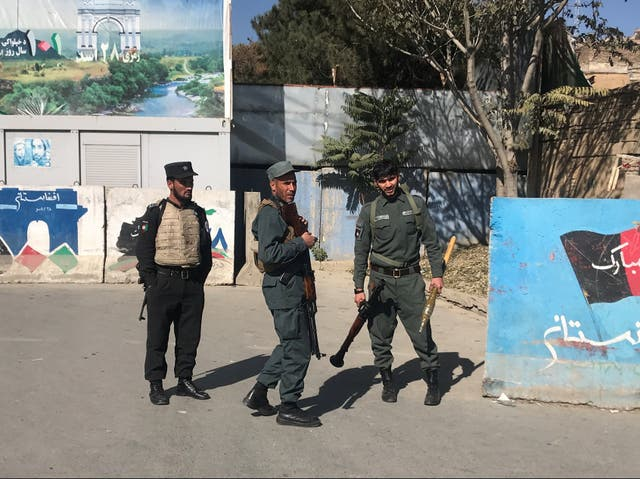 <p>Afghan policemen keep watch near the site of an attack at Kabul University</p>