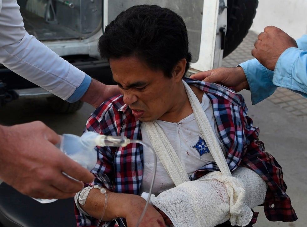 A man wounded in the Kabul University attack arrives at Isteqlal Hospital