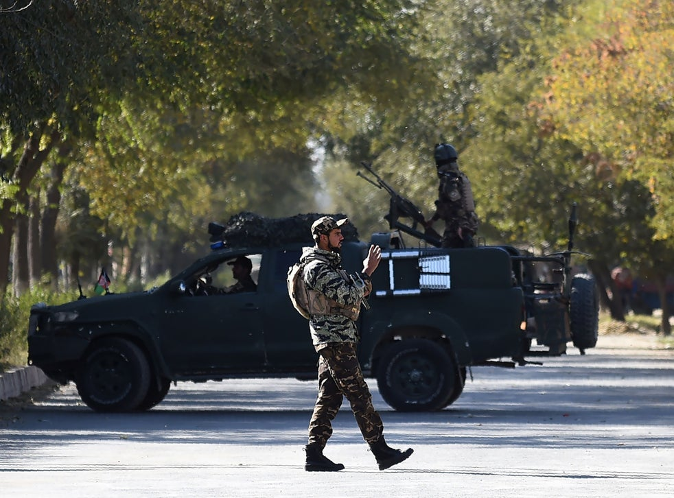 Armed security personnel stand guard outside Kabul University
