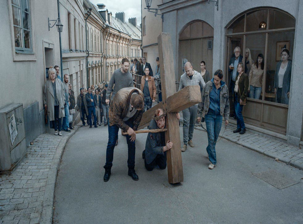 <p>Cross to bear: one vignette focuses on a priest who's lost his faith</p>