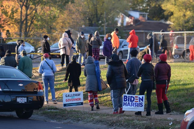 Voters wait on line to cast their ballots on Election Day on November 3, 2020 at Jennings Senior High School in St Louis, Missouri.