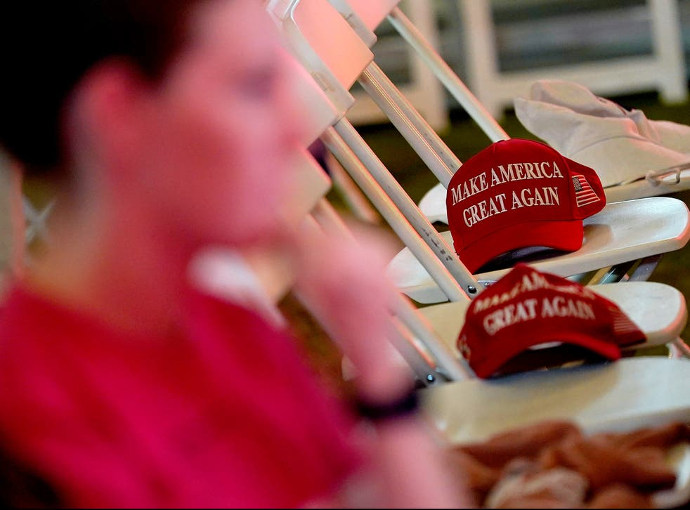 <p>MAGA hats sit on empty seats during an election watch party, Tuesday, Nov. 3, 2020, in Chandler, Arizona</p>