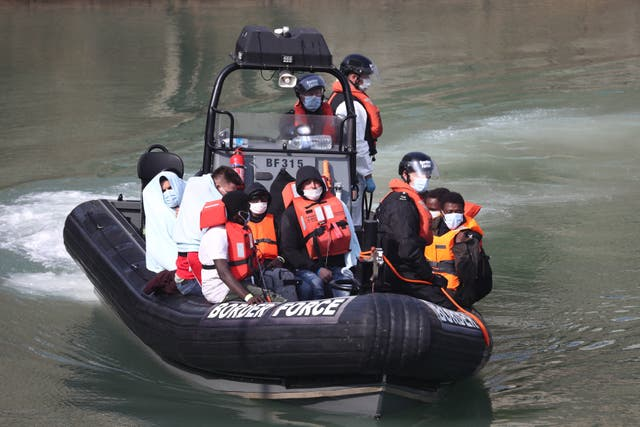 A Border Force patrol with migrants from a small boat in the English Channel