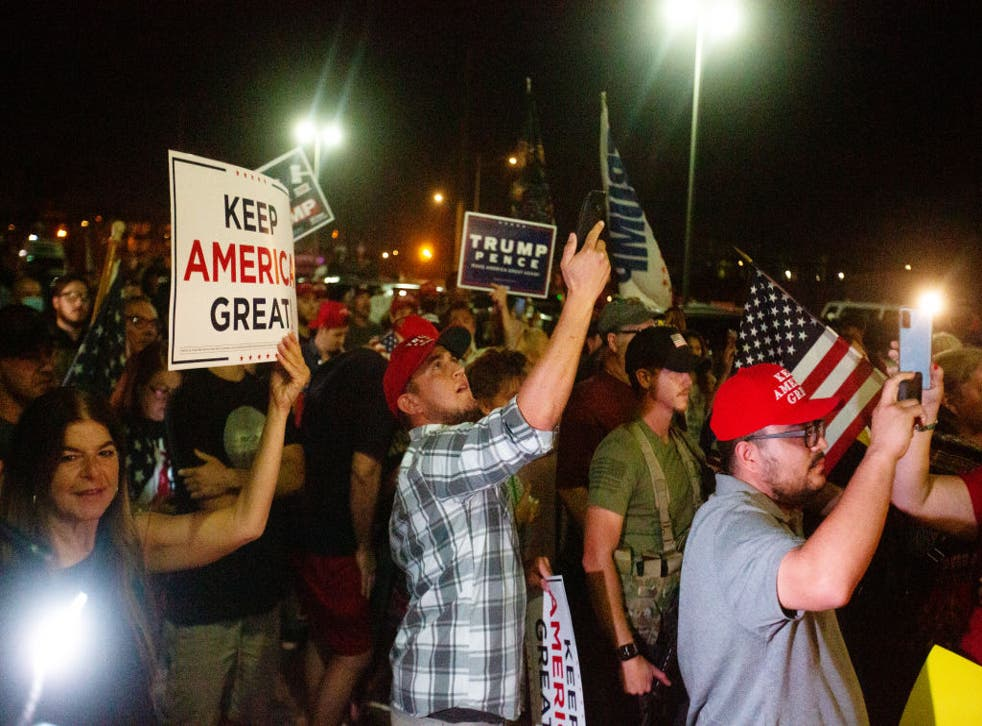 <p>Pro-Trump demonstrators gathered outside the Maricopa County Elections Office building on Wednesday as the Arizona vote count continued rolling in</p>