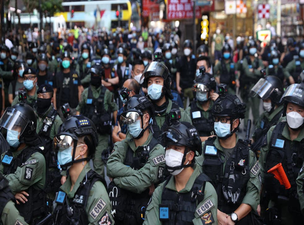 Police officers stand guard during a banned rally on China's National Day in Hong Kong, China, 01 October 2020.