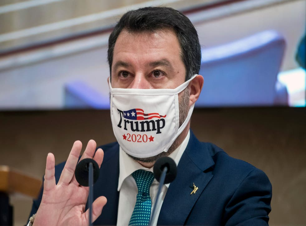 Far-right Lega party leader Matteo Salvini wears a face mask in support of Donald Trump as he gives a press conference on his party's alternative proposals to the government's decree to curb the spread of COVID-19, at the Senate, in Rome, on Tuesday 3 November.