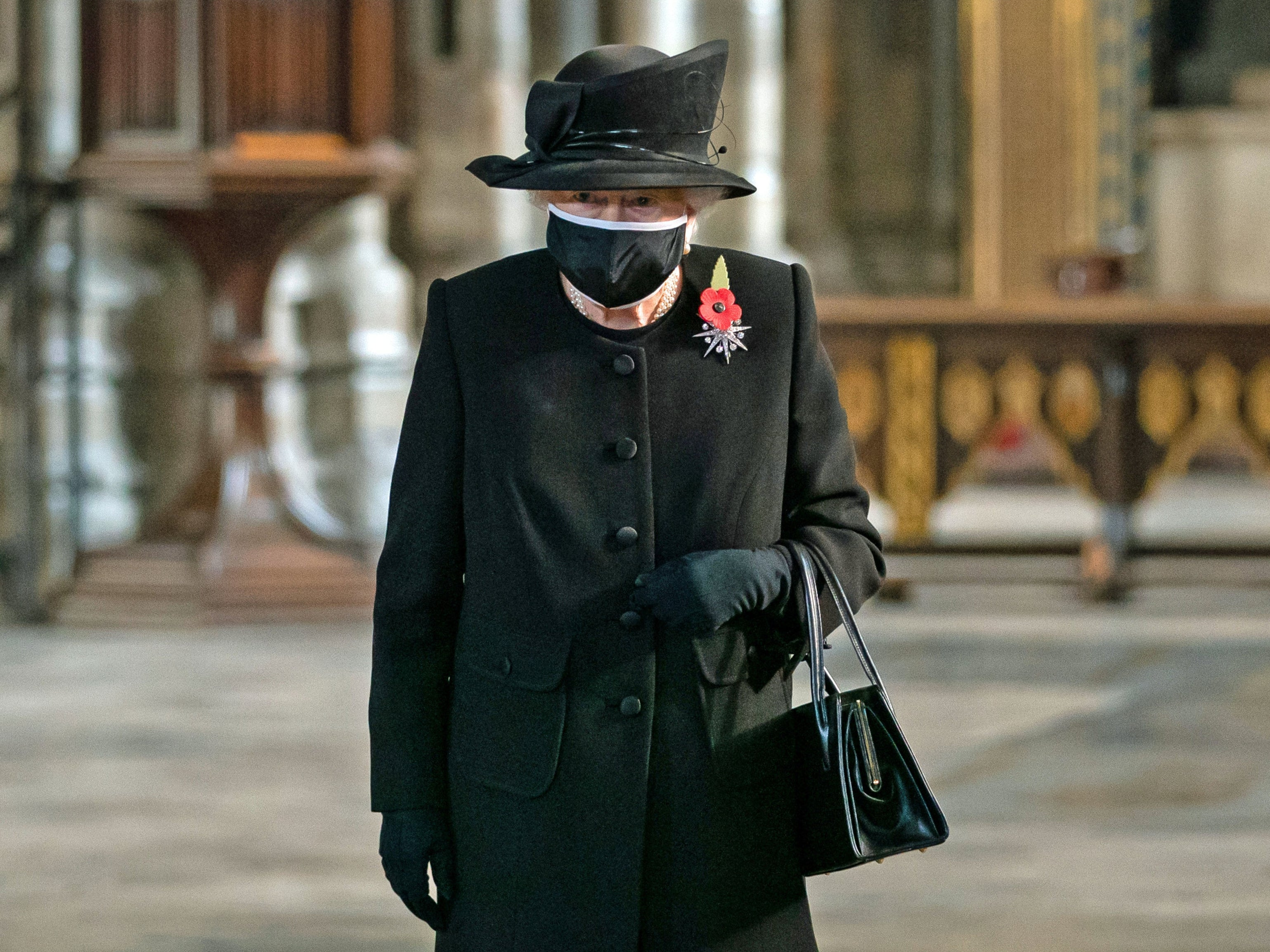 The Queen has been seen wearing a face mask for the first time