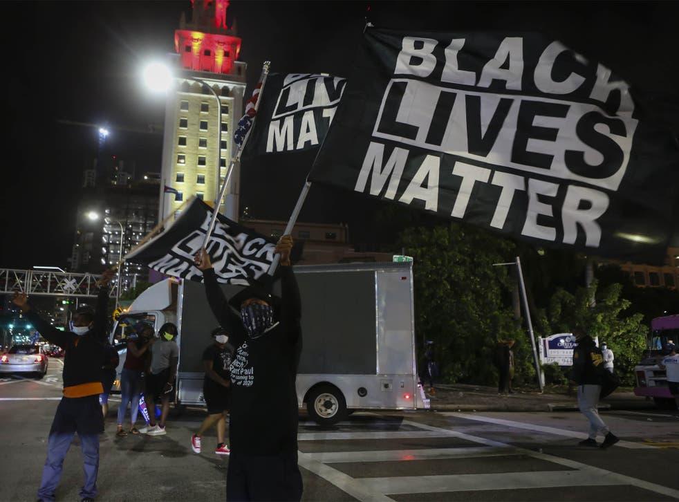 <p>Black Lives Matter protestors celebrating Joe Biden's win as 46th US President in Miami, Florida, 7 November</p>