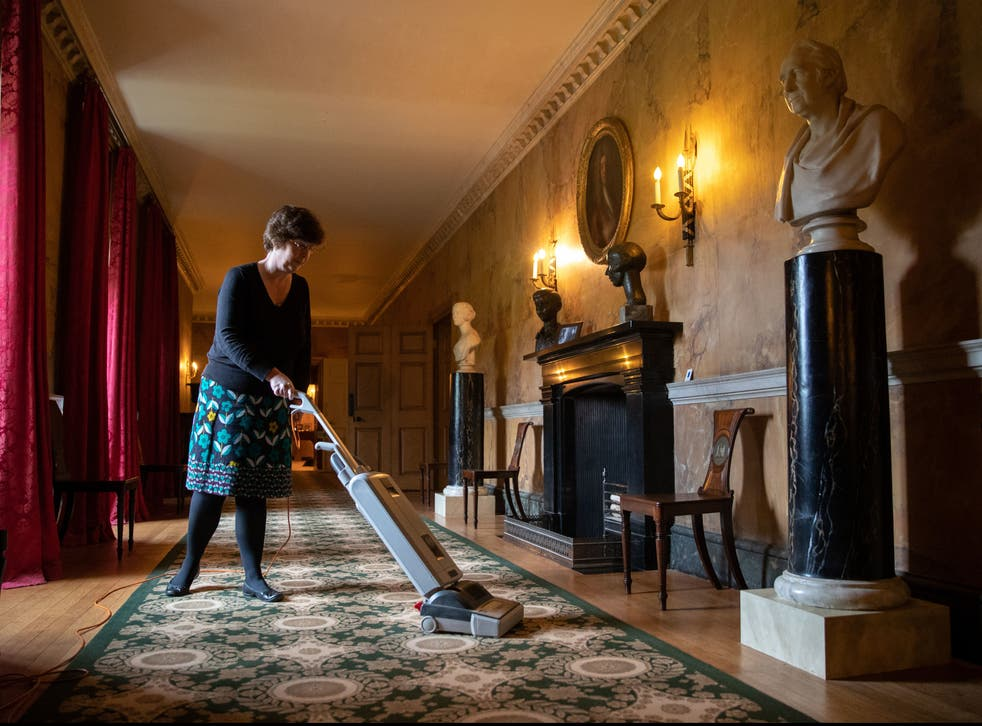 A staff member cleans the carpet at the National Trust's Mottisfont Abbey in Hampshire