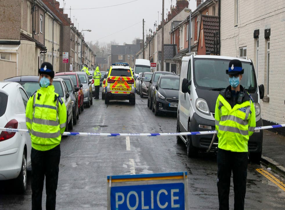 Police at the scene of the shooting in Summers Street, Swindon