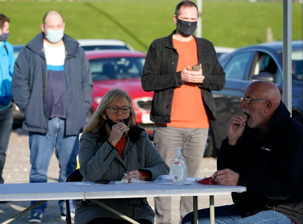 <p>Covid-19 testing is carried out at an NHS Test and Trace facility at Wavertree Sports Park in Liverpool</p>