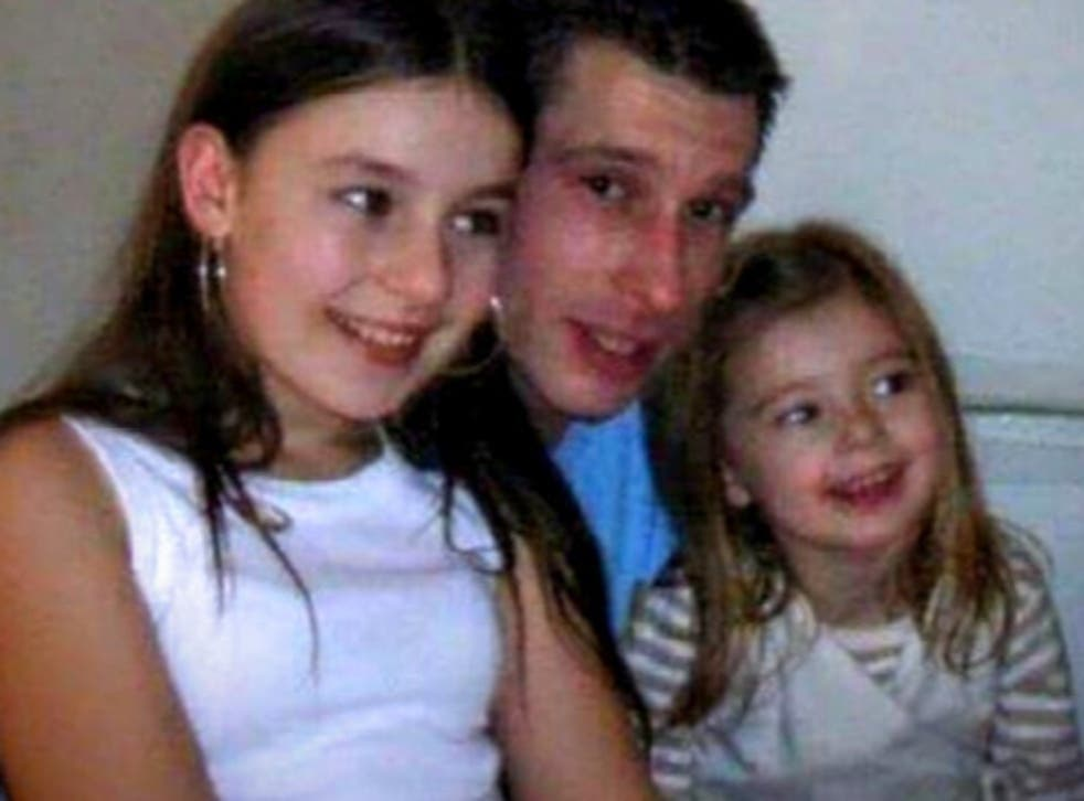 Robert Duff, who has been missing since 2013, pictured with his two daughters