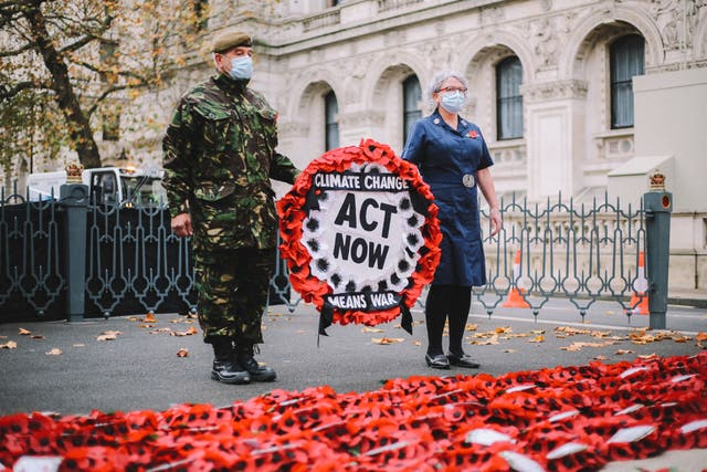 <p>Protest: veteran Donald Bell lays XR wreath at the Cenotaph on Remembrance Day</p>
