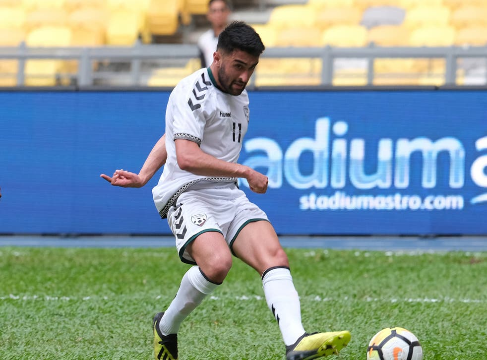<p>Maziar Kouhyar in action for Afghanistan</p>