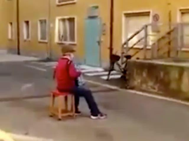 Stefano Bozzini serenading his wife from outside hospital