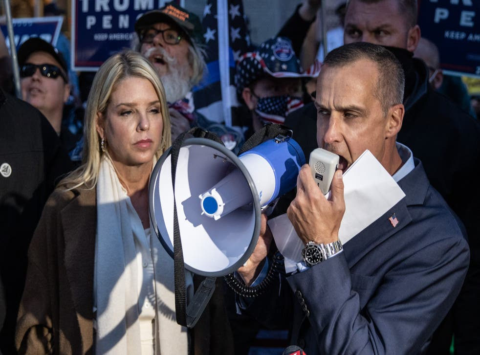 Former campaign adviser to U.S. President Donald Trump, Corey Lewandowski (R) and former Florida Attorney General Pam Bondi speak to the media about a court order giving the Trump campaign access to observe vote counting operations on November 5, 2020 in Philadelphia, Pennsylvania. With no winner yet declared in the presidential election, all eyes are on the outcome of a few remaining swing states.