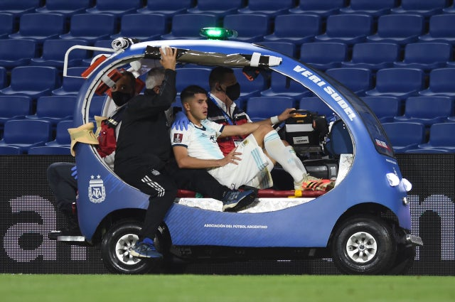 Argentina's Exequiel Palacios is taken out of the field in a cart after getting injured   during the closed-door 2022 FIFA World Cup South American qualifier football match against Paraguay at La Bombonera Stadium in Buenos Aires on November 12, 2020.
