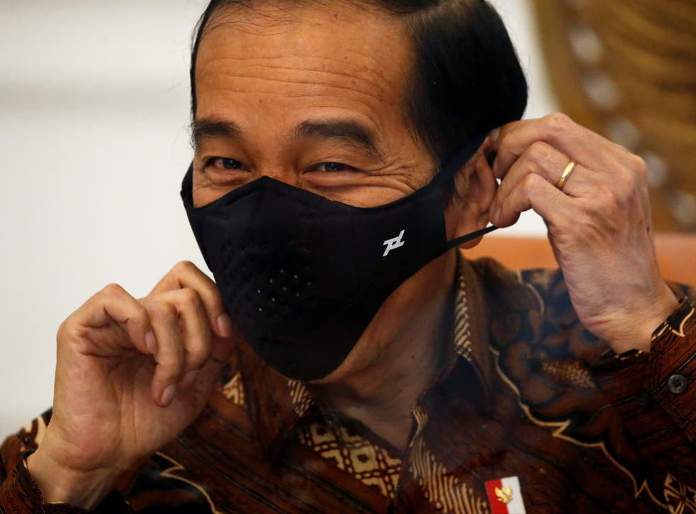 Joko Widodo wears a mask during an interview at the Presidential Palace in Jakarta