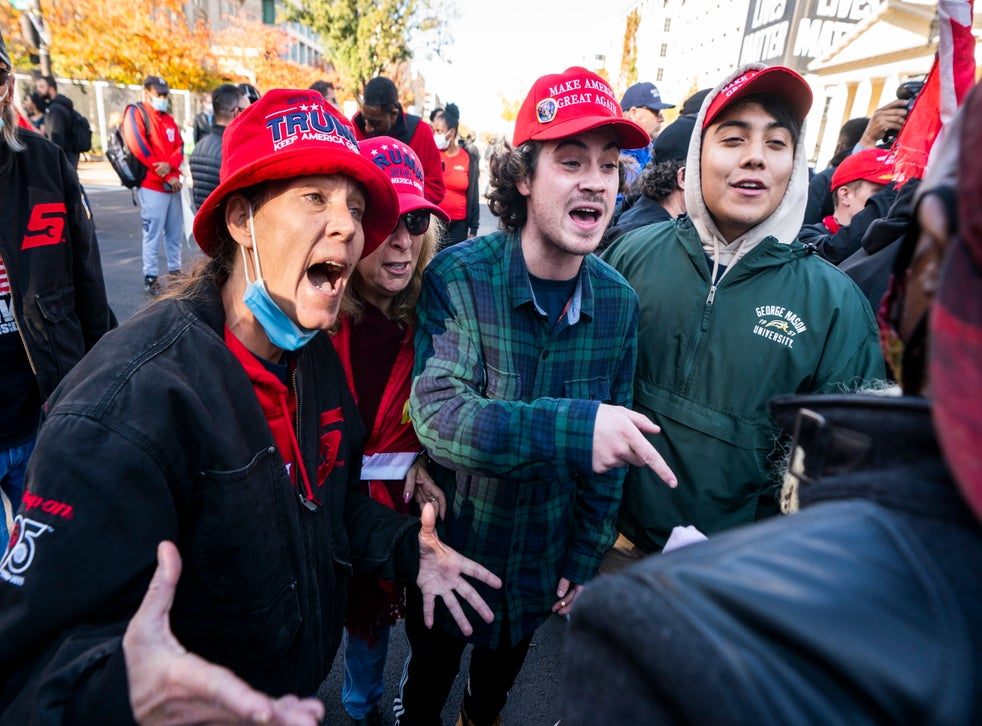 Supporters of US President Donald J. Trump clash with a supporter of President-elect Joe Biden in Black Lives Matter (BLM) plaza outside the White House ahead of an upcoming rally to support Trump's baseless claims of voter fraud in the 2020 presidential election in Washington, DC, USA, 13 November 2020. On 14 November, Pro-Trump and White Nationalist groups plan to converge on DC to protest the election. On 12 November, the Cybersecurity and Infrastructure Security Agency, a division of the Department of Homeland Security, stated 'the November 3rd election was the most secure in American history.'  EPA/JIM LO SCALZO