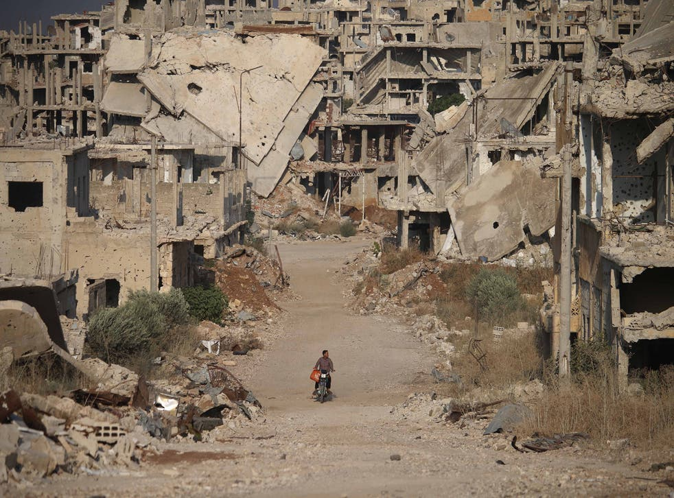 <p>A destroyed street in the city of Daraa in 2018</p>