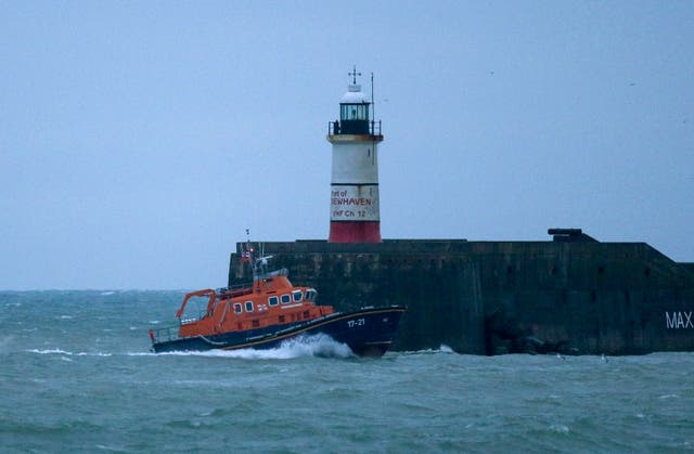 RNLI Lifeboat heads to Newhaven harbour after searching for the missing crew