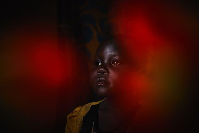 <p>A portrait of Prisca*, six, inside her home in the Democratic Republic of Congo</p>