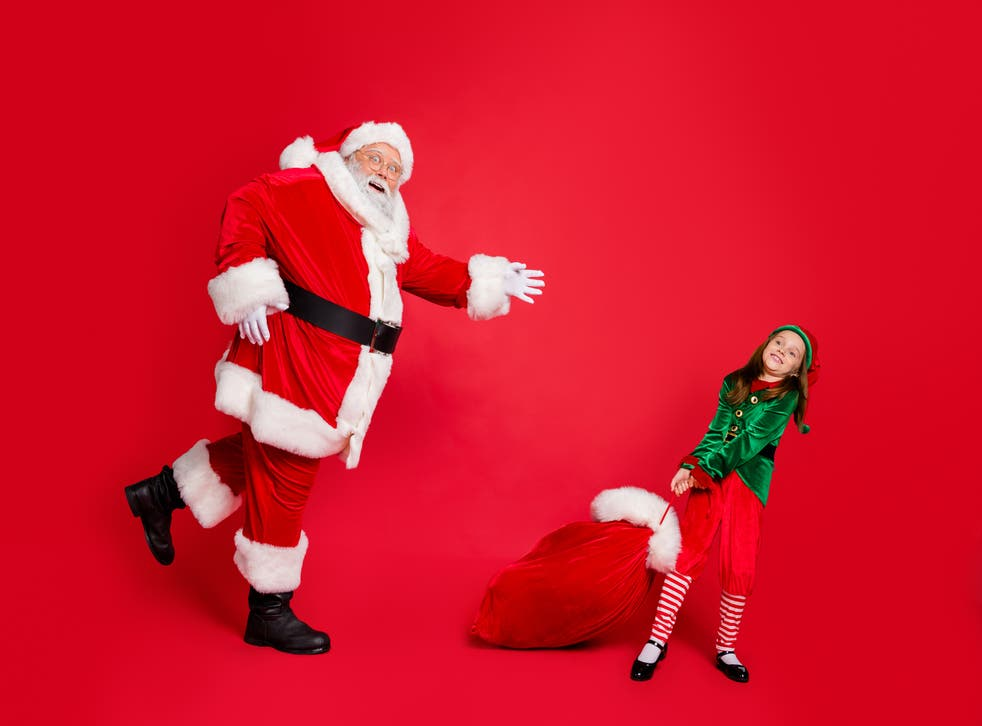 <p>Santa chasing an elf with a bag of toys</p>