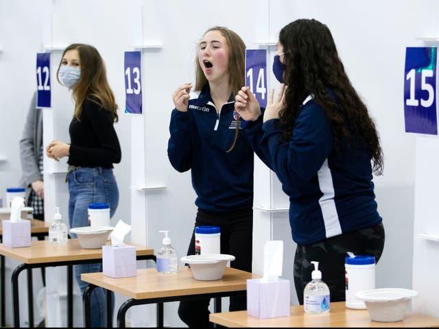 Students get a Covid-19 test at St Andrews University in Scotland ahead of the Christmas holiday