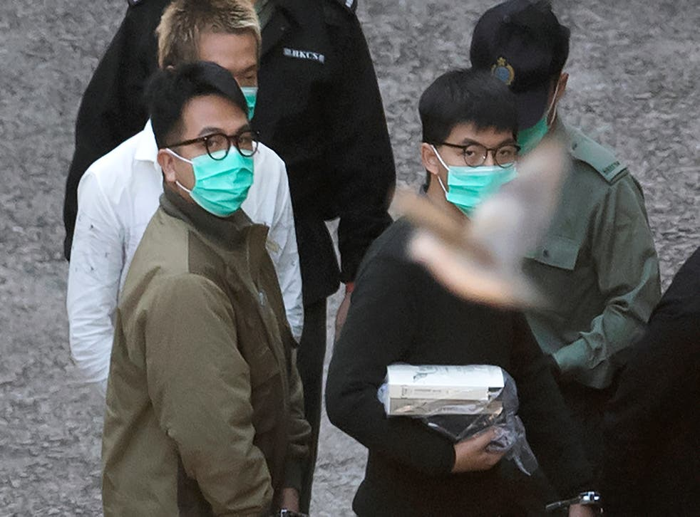 <p>Hong Kong pro-democracy activists Joshua Wong, Agnes Chow and Ivan Lam were handed prison sentences on Wednesday</p>