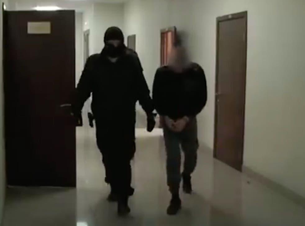 Radik Tagirov, who was arrested on suspicion of killing 26 elderly women, is pictured in custody in Russia.