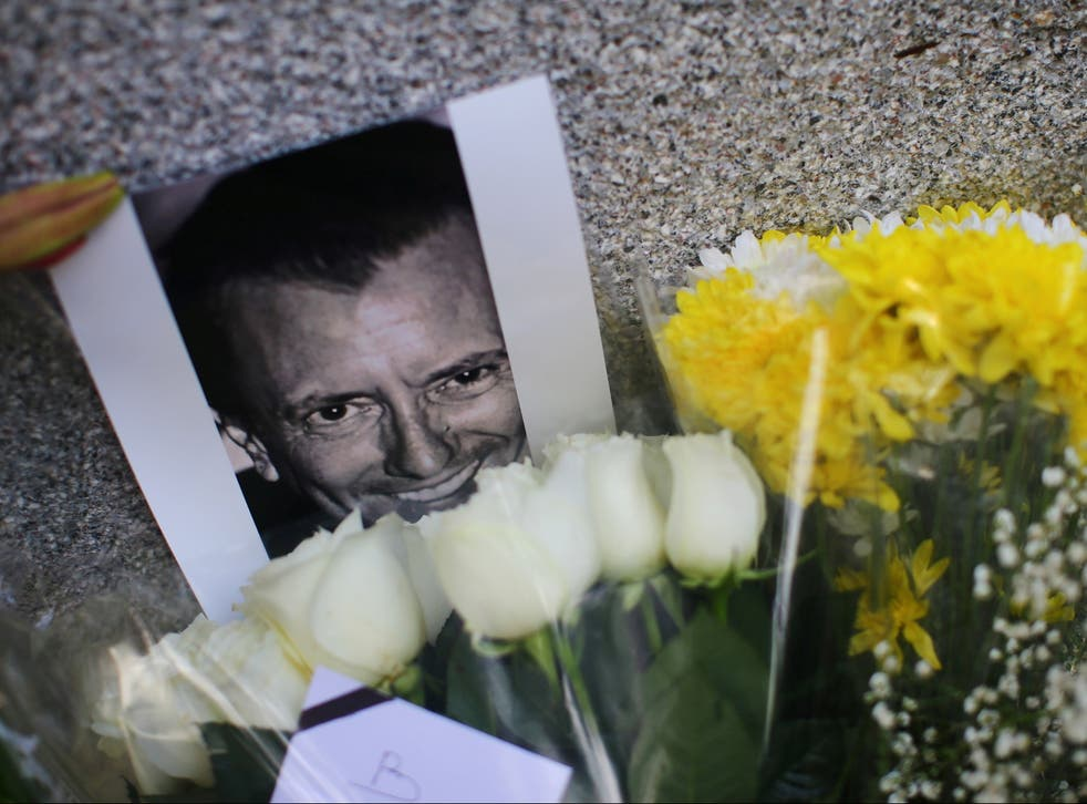 <p>An image of French restaurateur Baptiste Lormand is pictured alongside floral tributes outside the French embassy in Mexico City</p>