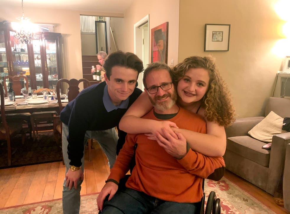 Samuel Kolb, seated, with his son Jacob and daughter Lexi