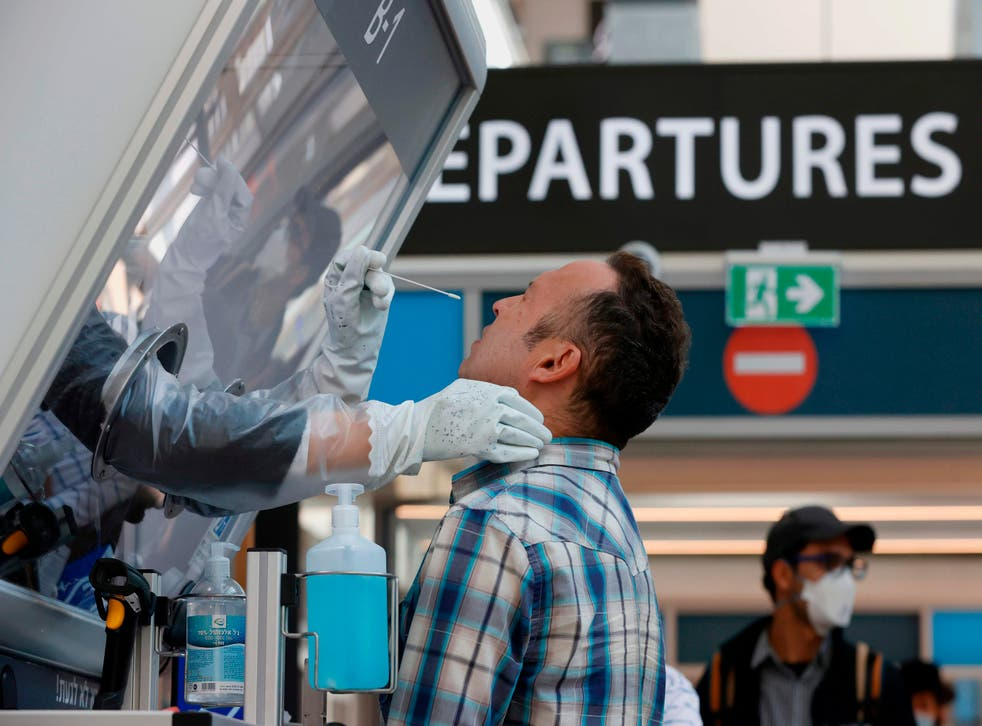 <p>A man is tested for coronavirus at Israel's Ben Gurion International Airport</p>
