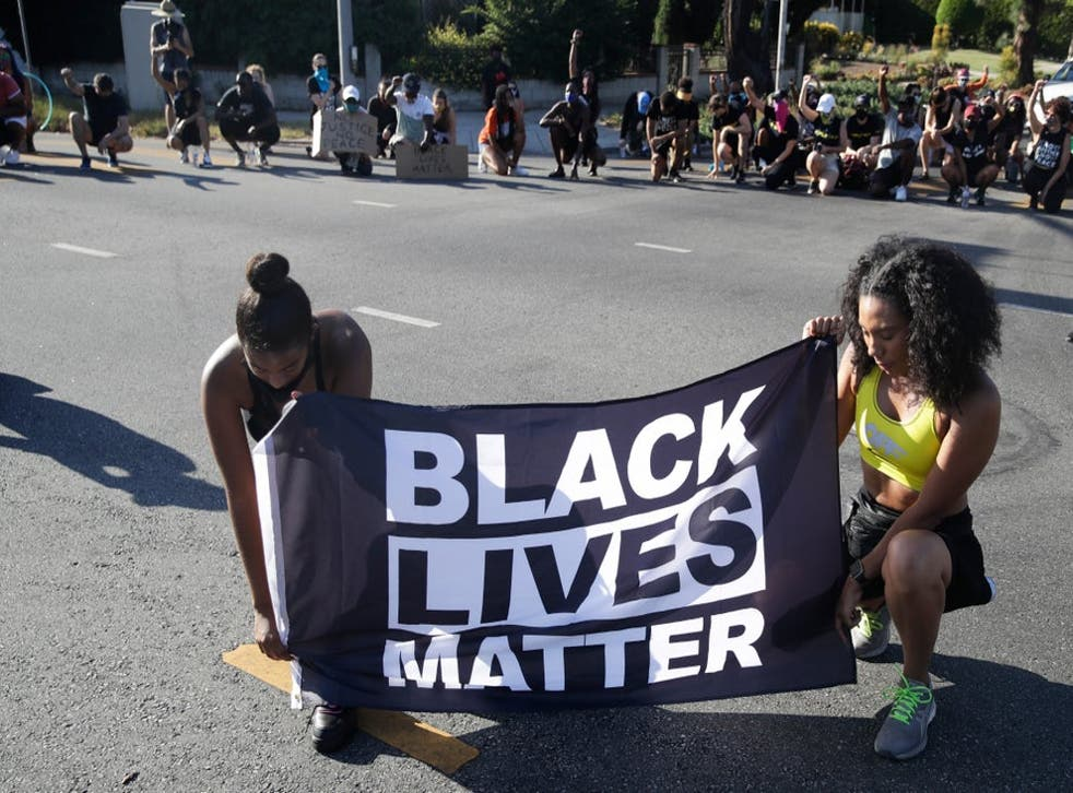 Protesters display a BLM banner