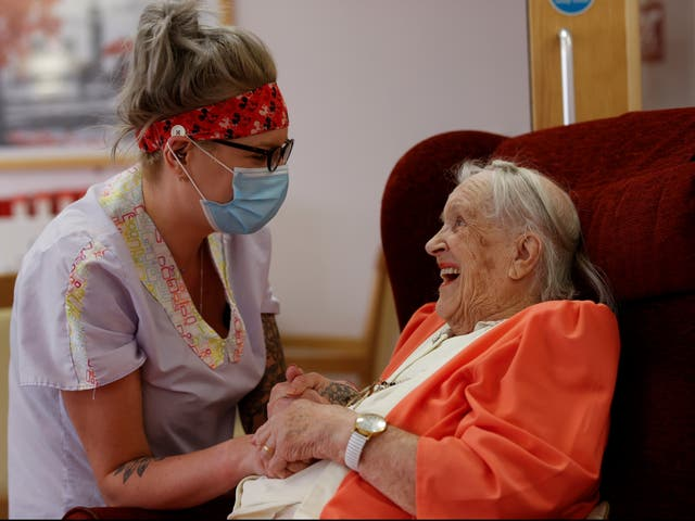 <p>Carer Lucy Skidmore decided to stay on site at a care home in Princes Risoborough with six colleagues to reduce the risk of bringing Covid-19 into the home. Here she spends time with her 100-year-old great-grandmother and resident Joan Loosley</p>