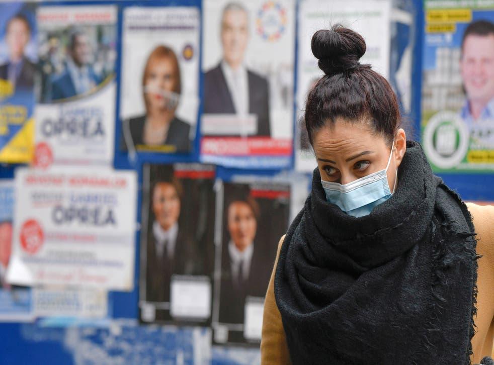 Virus Outbreak Romania Elections