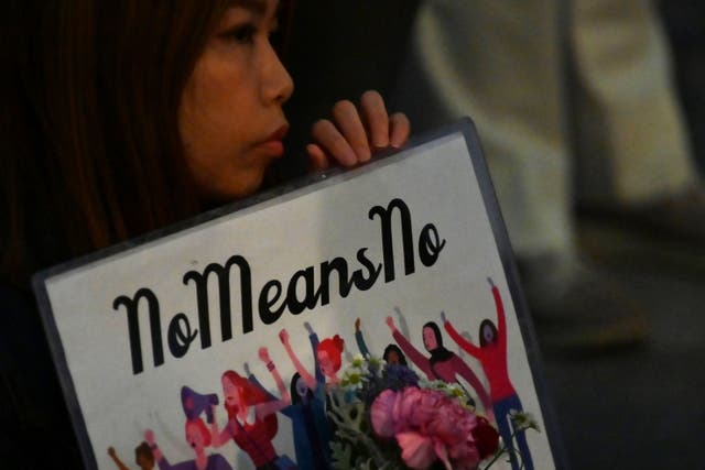 <p>A demonstrator holds a placard during a protest against the lack of substantial legal protection for sexual assault victims in Tokyo in June 2019</p>