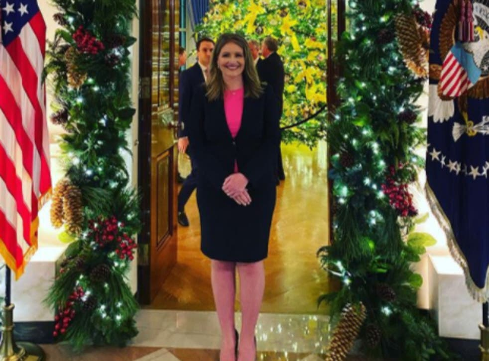 <p>Jenna Ellis posted a photo of herself at a White House Christmas party on Friday night</p>
