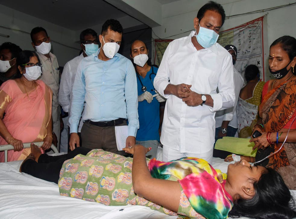 <p>Andrha Pradesh Health minister Alla Nani visits patients receiving medical care for a mystery illness at a goverment hospital in Eluru</p>