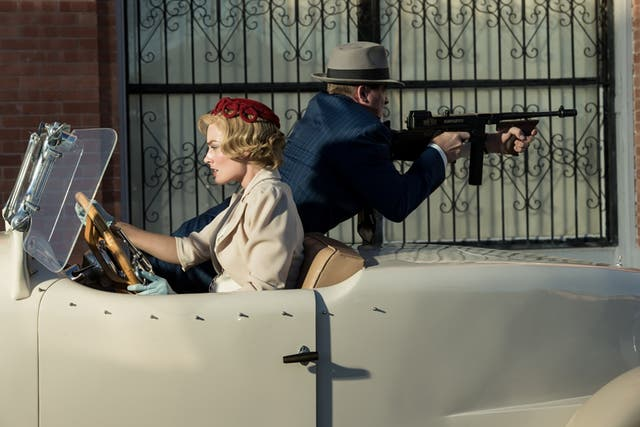 <p>Margot Robbie as a bank robber on the run in Dreamland</p>