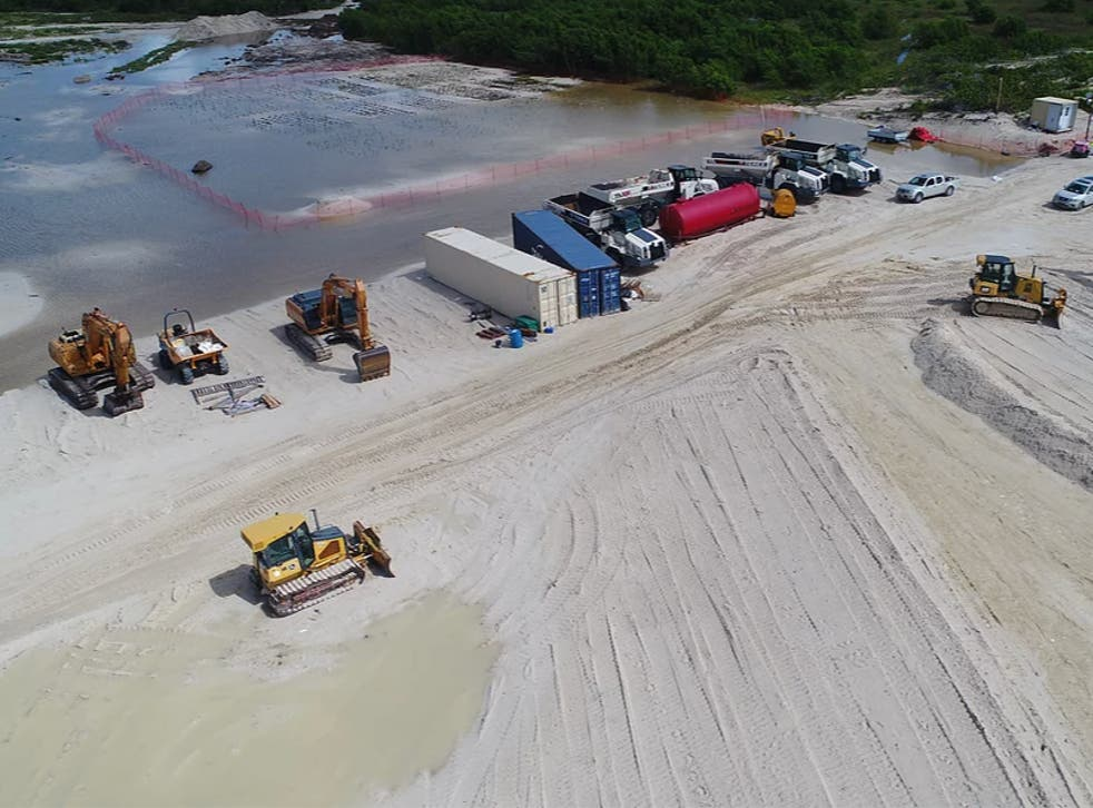 A construction site with heavy machinery at Barbuda's Codrington Lagoon National Park, a designated wetland of international importance under the Ramsar Convention, on October 10, 2020