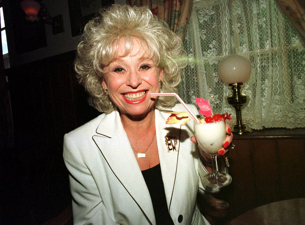 Barbara Windsor enjoys a cocktail at the White Hart Hotel in Essex, 1996