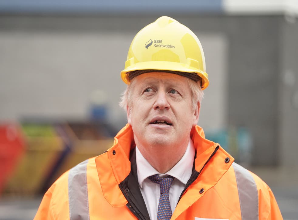 <p>Boris Johnson visits the National Renewable Energy Centre in green clothes that are actually orange</p>
