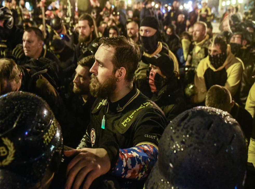 <p>Members of the far-right group Proud Boys gather in Washington DC on 12 December, 2020</p>